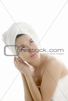 Beautiful woman with bath towel on white