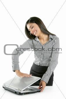 Beautiful brunette woman closing laptop