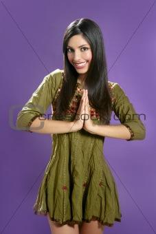 Beautiful indian young brunette woman posing hands