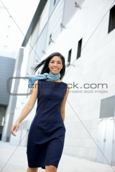 Beautiful stewardess walking to convention center