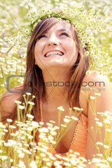 Beautiful young woman on the meadow