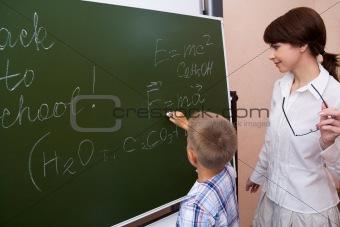 By the blackboard