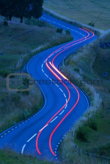 view of traffic on curvy winding road in southern sweden