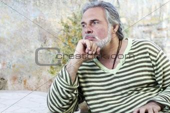 Mature man outdoors, thinking