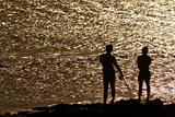 two friends fishing in black silhouette