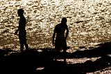 two friends standing in black silhouette