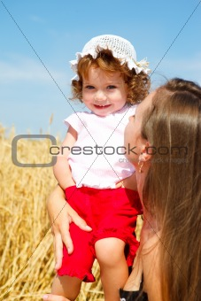 Toddler in wheat field