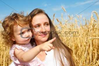 Girl showing something to her mother