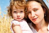 Mom and daughter in wheat