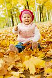 Laughing autumn kid