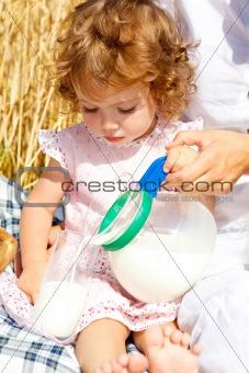 Girl pouring milk