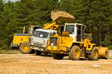 Heavy bulldozer loading ballast on the lorry