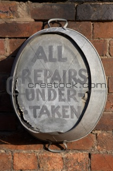 old tin bath hanging on a wall