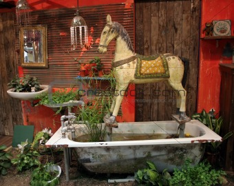 Antique wooden horse set in old bathtub