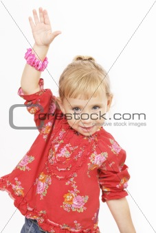 Little girl in red with hand up