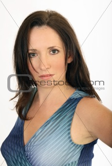 Portrait of lady in blue top looking serious