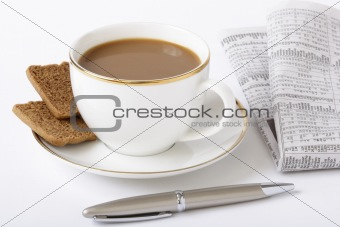 Business breakfast composition: coffee, newspaper, fountain pen