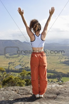 Lady standing on the mountain top