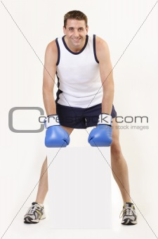 Boxer with blue gloves holding a white board 3