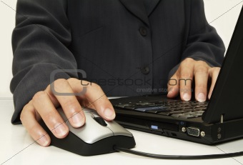 Corporate person using laptop & mouse close up