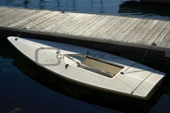 Small Docked White Boat