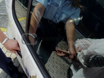 Policewoman arresting someone