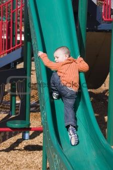 Little Boy Going Up the Slider