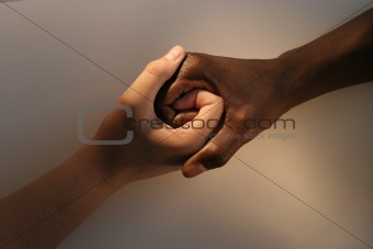 White female and Black African holding hands
