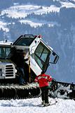Snowcat driver and skier talking