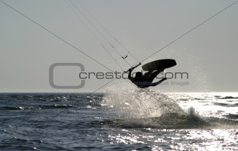 kiteboarder taking off for a jump