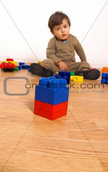 baby playing in empty room