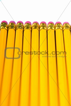 row of yellow pencils with eraser
