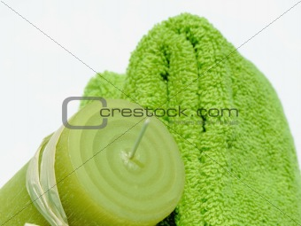 Green towels and candle