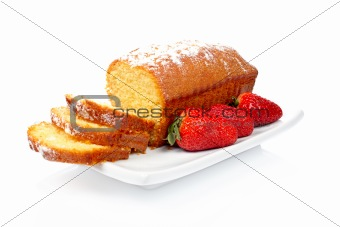 Slices of cake with three strawberries