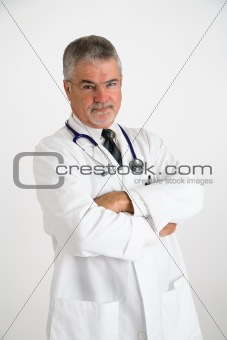 Doctor with arms crossed and concerned look