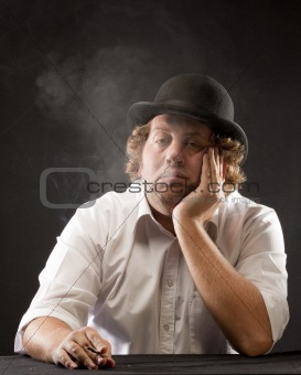 Bowler hat man blowing smoke