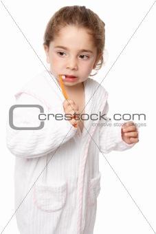 Little girl brushing her teeth - dental care