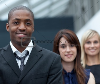 Afro-American businessman in front of his colleages