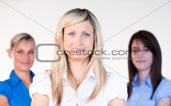 Three beautiful businesswomen smiling at the camera