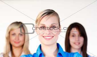 Portrait of three businesswomen smiling at the camera
