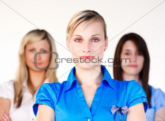 Three confident businesswomen looking at the camera