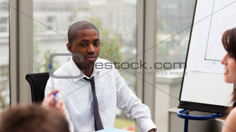 Afro-American businessman interacting with his colleagues
