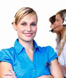 Beautiful businesswoman in a call center 