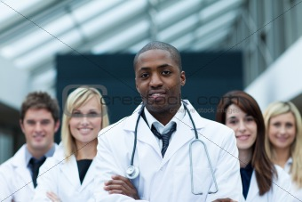 Afro-American doctor leading his team with folded arms