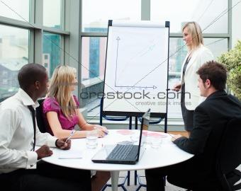 Beautiful businesswoman giving a presentation