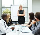 Attractive businesswoman in a meeting with folded arms