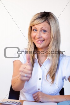 Beautiful businesswoman with thumbs up in office