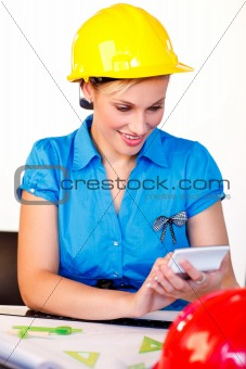 Portrait of young woman with hard hat