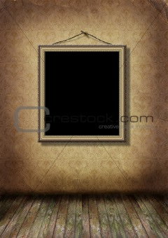 Gold frame hangs on an old wall