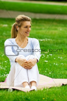 Blonde girl in park relaxing